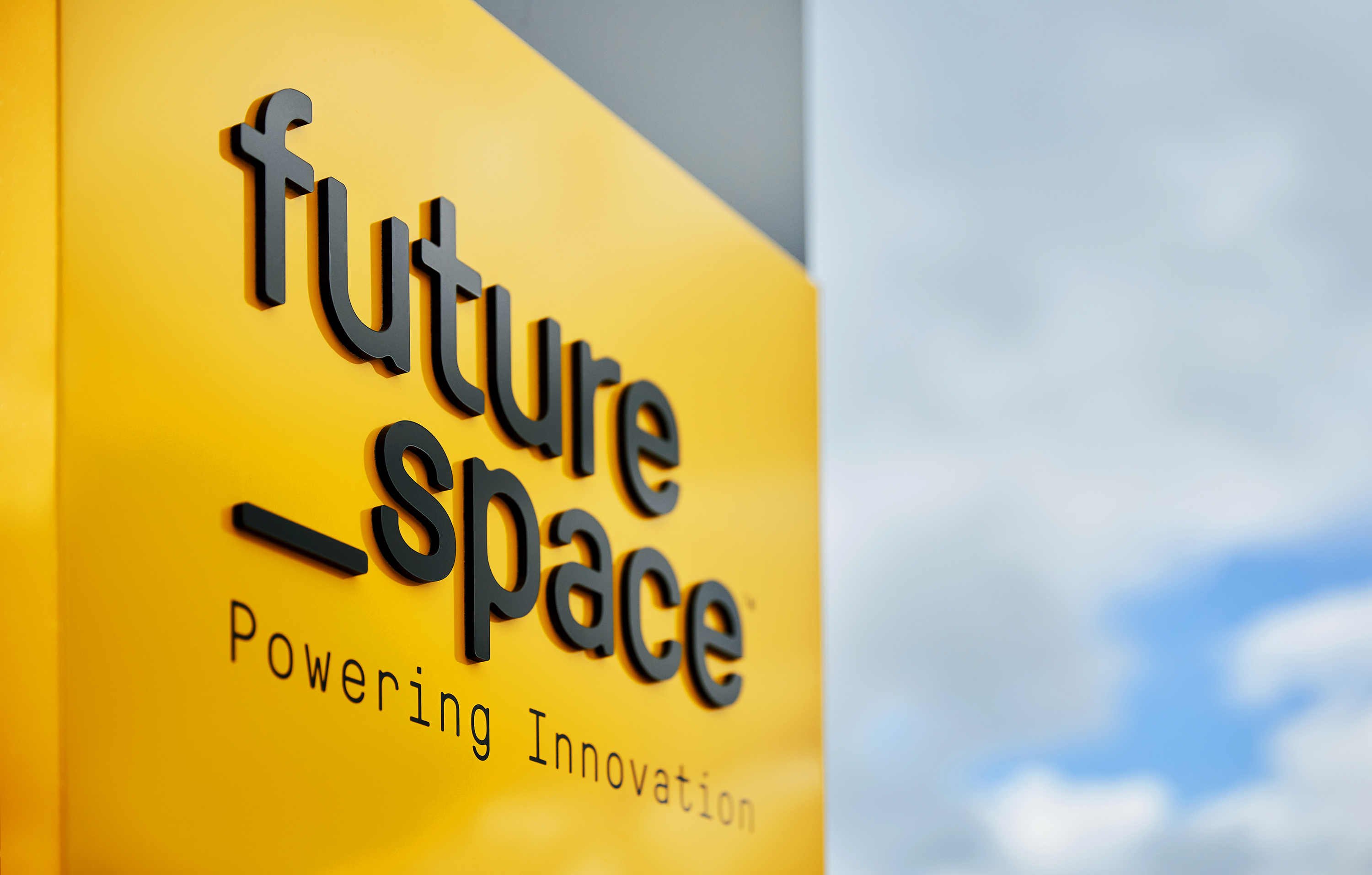 Exterior signage of future space branding by Fiasco Design